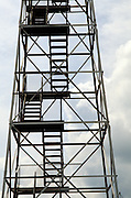 steel stairs in watchtower against sky