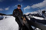 Italy, Madonna di Campiglio, Gino BRESADOLA, take tourists with his snowscooter to his refuge restaurant Malga Ritordo
