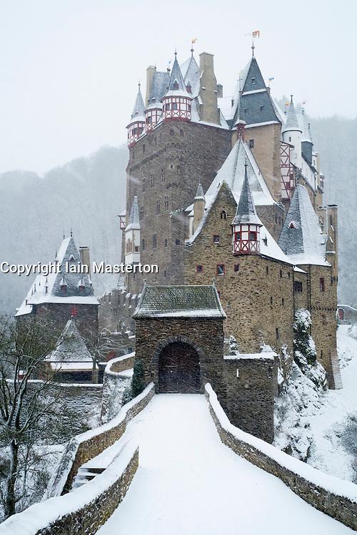 View of Burg Eltz castle in winter snow in Germany