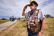29 AUGUST 2020 - RUNNELLS, IOWA: A member of the Patriot Guard Riders salutes as the hearse carrying the remain of Pvt Roy Brown Jr arrives at the funeral for Pvt. Brown's funeral in Runnells, IA. Pvt. Brown was a US Army soldier in World War II. He was an infantryman in the 126th Infantry Regiment, 32nd Infantry Division, serving in the Australian Territory of Papua (now Papua New Guinea). He went missing in action on Dec. 2, 1942. Unidentified remains were recovered on Feb. 2, 1943 and were eventually interred in the Manila American Cemetery. On May 14, 2019, Defense POW/MIA Accounting Agency using dental records, circumstantial evidence and DNA identified the remains as Pvt. Brown's. He was reinterred in the Lowman Cemetery in Runnells Saturday.     PHOTO BY JACK KURTZ