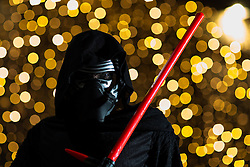 © Licensed to London News Pictures . 16/12/2015 . Manchester , UK . Kylo Ren outside the cinema . Star Wars fans attend the midnight screening of Star Wars the Force Awakens at the AMC Great Northern cinema in Manchester City Centre . Photo credit : Joel Goodman/LNP