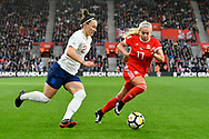 Lucia Bronze (2) of England on the attack with Charlotte Estcourt (17) of Wales closing her down during the FIFA Women's World Cup UEFA Qualifier match between England Ladies and Wales Women at the St Mary's Stadium, Southampton, England on 6 April 2018. Picture by Graham Hunt.