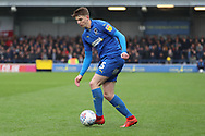 AFC Wimbledon defender Steve Seddon (15) dribbling during the EFL Sky Bet League 1 match between AFC Wimbledon and Accrington Stanley at the Cherry Red Records Stadium, Kingston, England on 6 April 2019.