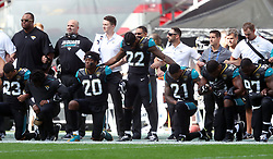 File photo dated 24-09-2017 of Jacksonville Jaguars players kneel in protest during the national anthem