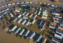 © Licensed to London News Pictures. 23/12/2019. Yalding, UK. The Little Venice Caravan Park remains flooded after the River Medway (top) burst it's banks -  near Yalding in Kent. River levels are slowly beginning to drop after days of heavy rain in the south. Photo credit: Peter Macdiarmid/LNP