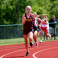Clymer's Mallory Dueink comes out of the final turn to win the girls 400 meters photo by Mark L. Anderson