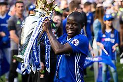 N'Golo Kante holds the trophy as Chelsea celebrate winning the 2016/17 Premier League - Rogan Thomson/JMP - 21/05/2017 - FOOTBALL - Stamford Bridge - London, England - Chelsea v Sunderland - Premier League..