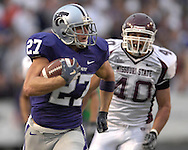 MANHATTAN, KS - SEPTEMBER 15:  Wide receiver Jordy Nelson #27 of the Kansas State Wildcats rushes down field past defender Connor McDonough #40 of the Missouri State Bears for a 61-yard pass play in the second quarter, during a NCAA football game on September 15, 2007 at Bill Snyder Family Stadium in Manhattan, Kansas.  (Photo by Peter Aiken/Getty Images) *** Local Caption *** Jordy Nelson; Connor McDonough