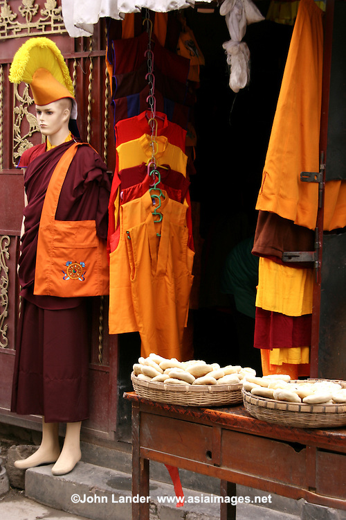 Monk Clothing and Accessories shop - Barkhor Square is an area of narrow streets and a public square located around Jokhang Monastery in Lhasa. <br />