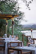 Table settings at Seera Cafema Camp, overlooking river kerosene lamps on tables, Kunene River, Hartmanns Valley, Northern Namibia, Southern Africa