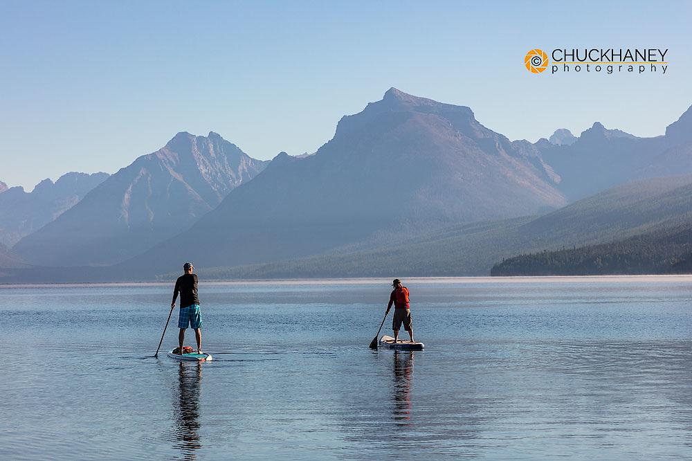 Standup paddleboarding on Lake McDonald in Glacier National Park, Montana, USA MR
