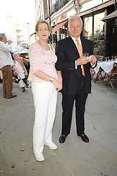 """MR & MRS ALEXANDER WATENPHUL at a party to celebrate the publication of the Paper back edition of """"A Lion Called Christian"""" held at Julie's Restaurant & Bar, 135 Portland Road, London W11 on 28th June 2010."""