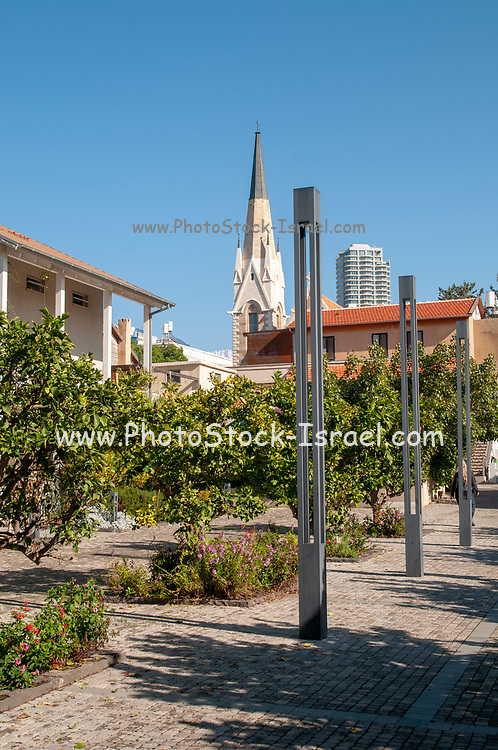 The Village renovation project in the American Colony, Tel Aviv, Israel. The belfry of the Immanuel Church in the background