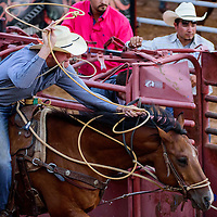 062615       Cable Hoover<br /> <br /> Tyler Milligan spins his lasso as he chases the calf from the gate in tie down roping during the Best of the Best Timed Event Invitational youth rodeo Friday at Red Rock Park.