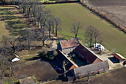 Nederland, Limburg, Gemeente Echt, 07-03-2010; Schilberg, Hof 'De Echt; Limburgse (versterkte) boerderij, de stallen en andere gebouwen gegroepeerd rond binnenplaats of hof.Limburg (fortified) farm, stables and other buildings grouped around courtyard or garden..luchtfoto (toeslag), aerial photo (additional fee required).foto/photo Siebe Swart
