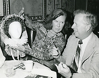 1978 Radio commentator/interviewer, Gregg Hunter is seen interviewing Peg Long during his KIEV radio show at the Hollywood Brown Derby Restaurant, on Vine St.