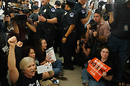 Protesters wearing Be A Hero T-shirts sat  down to be   arrested, in front of Senator Susan Collins office, asking her to vote no on Supreme Court nominee Judge Brett M. Kavanaugh.  The day ended with 128 arrests in the Russell Senate Office Building.