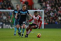 Football - 2016 / 2017 Premier League - Southampton vs. Middlesbrough<br /> <br /> Southampton's Sofiane Boufal turns away from Adam Forshaw of Middlesbrough at St Mary's Stadium Southampton England<br /> <br /> COLORSPORT/SHAUN BOGGUST