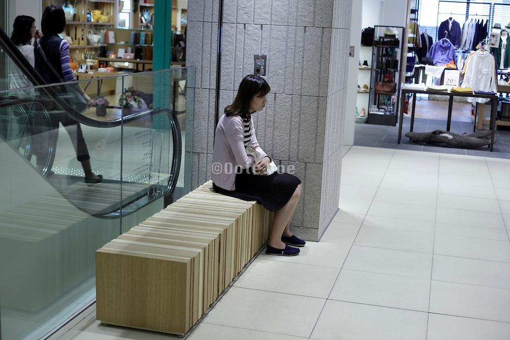female sitting alone in a corner