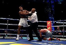 Referee David Fields gets between Wladimir Klitschko and Anthony Joshua following a knockdown during his IBF, WBA and IBO Heavyweight World Title bout against Anthony Joshua at Wembley Stadium, London.