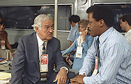 John Connolly talks to Bernard Shaw in the CNN office at the Democratic Convention in San Francisco, CA in July 1984..Photograph by Dennis Brack bs b 17