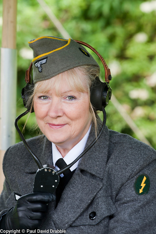 reenactor dressed as German army female signals auxiliary (Nachrichtenheflrennin des heeres) also nicknamed Blitzmädchen or lightening girls because of the signals insignia on their uniforms.<br /> Stanhope War on the line Weardale Railway Co Durham<br /> 14 July 2012<br /> Image © Paul David Drabble
