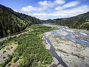 Revegetation of the former lakebed behind the Elwha dam is now complete.  The Elwha River flows at the right.  (Steve Ringman / The Seattle Times)