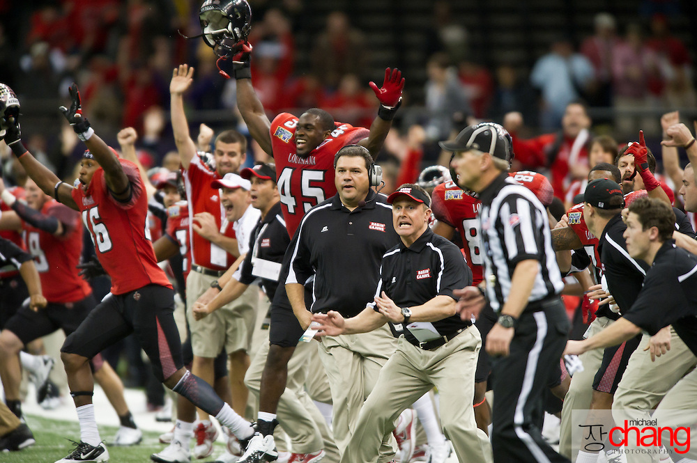 Louisiana-Lafayette's coaches and players celebrate after a 50 yard field goal gives them the lead at the end of regulation during the R+L Carriers New Orleans Bowl at the Mercedes-Benz Superdome.  Louisiana-Lafayette defeated San-Diego State 32-30. (Copyright Michael Chang)