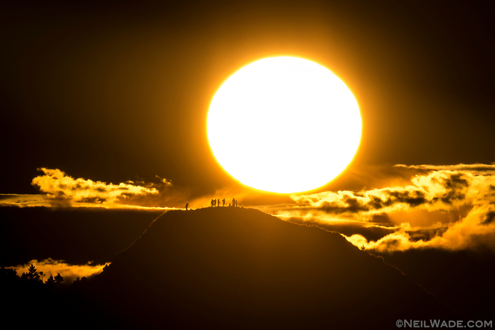 A group of Taiwanese hikers enjoy the sunrise on Taoshan Mountain in the Central Taiwan Mountains.
