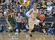 WICHITA, KS - NOVEMBER 14:  Guard Ron Baker #31 of the Wichita State Shockers brings the ball up court past guard Marcus Thornton #3 of the William & Mary Tribe during the first half on November 14, 2013 at Charles Koch Arena in Wichita, Kansas.  Wichita State defeated William & Mary 79-62. (Photo by Peter Aiken/Getty Images) *** Local Caption *** Ron Baker;Marcus Thornton
