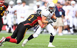 10.07.2011, Tivoli Stadion, Innsbruck, AUT, American Football WM 2011, Group A, Germany (GER) vs United States of America (USA), im Bild tackle from Oliver Radke (Germany, #27, DB) against Nate Kmic (USA, #1, RB)  // during the American Football World Championship 2011 Group A game, Germany vs USA, at Tivoli Stadion, Innsbruck, 2011-07-10, EXPA Pictures © 2011, PhotoCredit: EXPA/ T. Haumer