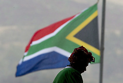 Dec. 10, 2013 - Johannesburg, South Africa - A woman makes her way past the South African flag as she walks up a ramp in the Soweto stadium where the memorial to Nelson Mandela was being held in Johannesbrug, South Africa, Tuesday December 10, 2013 THE CANADIAN PRESS/Adrian Wyld (Credit Image: © Adrian Wyld/The Canadian Press/ZUMAPRESS.com)