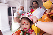 For the young girls who are selected to be Kumari, preparations and rituals can be overwhelming. Adu was not interested to be Kumari but had to reluctantly agree since no other girl was available because of the Covid-19 pandemic. As elder women from the Dutta family put on her make-up, Adu was quite annoyed.