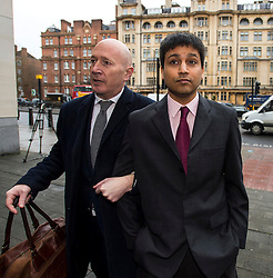 © Licensed to London News Pictures. 05/02/2016. London, UK. Trader NAVINDER SINGH SARAO (right)  arrives at Westminster Magistrates court in London with a member of his legal team (left). Sarao, nicknamed the Hound of Hounslow, is accused of contributing to the 2010 flash crash. He has been charged with 22 counts of fraud and market manipulation by the US authorities who want to extradite him. Photo credit: Ben Cawthra/LNP