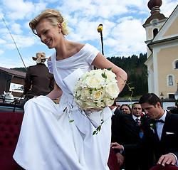 16.04.2011, Going am Wilden Kaiser, Tirol, AUT, kirchliche Trauung von Maria Riesch und Markus Höfl in der Pfarrkirche zum Hl. Kreuz, im Bild die Skirennfahrerin Maria Höfl-Riesch und ihr Ehemann Marcus Höfl besteigen die Hochzeitskutsche // the german skieracer Maria Riesch-Hoefl and her husband Marcus Hoefl during church wedding at Church of the Holy Cross in Going, Austria on 16/4/2011. EXPA Pictures © 2011, PhotoCredit: EXPA/ J. Groder / SPORTIDA PHOTO AGENCY
