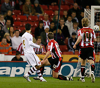 Photo: Steve Bond.<br /> Sheffield United v Arsenal. Carling Cup. 31/10/2007. eduardo (L) fires Arsenal in fron early on