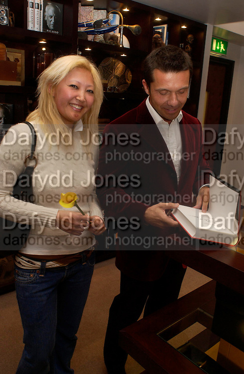 Nicole Davenport and Olivier Picasso. Olivier Widmaier Picasso's book launch for Picasso: The Real Family Story.  Co-hosted by dunhill CEO Simon Critchell and Prestel Publishing -  Dunhill, 48 Jermyn Street, London, SW1, 6.30-8.30pm. ONE TIME USE ONLY - DO NOT ARCHIVE  © Copyright Photograph by Dafydd Jones 66 Stockwell Park Rd. London SW9 0DA Tel 020 7733 0108 www.dafjones.com