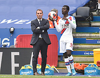 LEICESTER, ENGLAND - JULY 04: Tyrick Mitchell of Crystal Palace with a throw in as Leicester City manager Brendan Rogers looks on during the Premier League match between Leicester City and Crystal Palace at The King Power Stadium on July 4, 2020 in Leicester, United Kingdom. Football Stadiums around Europe remain empty due to the Coronavirus Pandemic as Government social distancing laws prohibit fans inside venues resulting in all fixtures being played behind closed doors. (Photo by MB Media)
