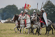William in red cape leads his troops - English Heritage's annual re-enactment of the Battle of Hastings marks the 950th anniversary of the Battle in 1066. The event includes a Cavalry encampment, Norman & Saxon encampments and Medieval traders. It takes place at Battle Abbey on October 15th and 16th.