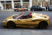 Gold Ferrari sports car on the Kings Road in Chelsea in London, England, United Kingdom.
