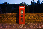 Public phone box at New Lanark, the industrial revolution community village managed by social pioneer Robert Owen. New Lanark is on the River Clyde, approximately 1.4 miles (2.2 kilometres) from Lanark, in South Lanarkshire, Scotland. It was founded in 1786 by David Dale, who built cotton mills  and housing for the mill workers. Dale built the mills there to take advantage of the water power provided by the river. Under the ownership of a partnership that included Dale's son-in-law, Robert Owen, a Welsh philanthropist and social reformer, New Lanark became a successful business and an epitome of utopian socialism. The New Lanark mills operated until 1968 and is now one of five UNESCO World Heritage Sites in Scotland.