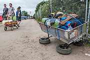 Two wheels on my trolly and someone is having difficulty getting home. The 2013 Glastonbury Festival, Worthy Farm, Glastonbury. 30 June 2013.  © Guy Bell, guy@gbphotos.com, all rights reserved