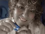Self-portrait of Karen Focht playing blues harmonica in Memphis, Tennessee.