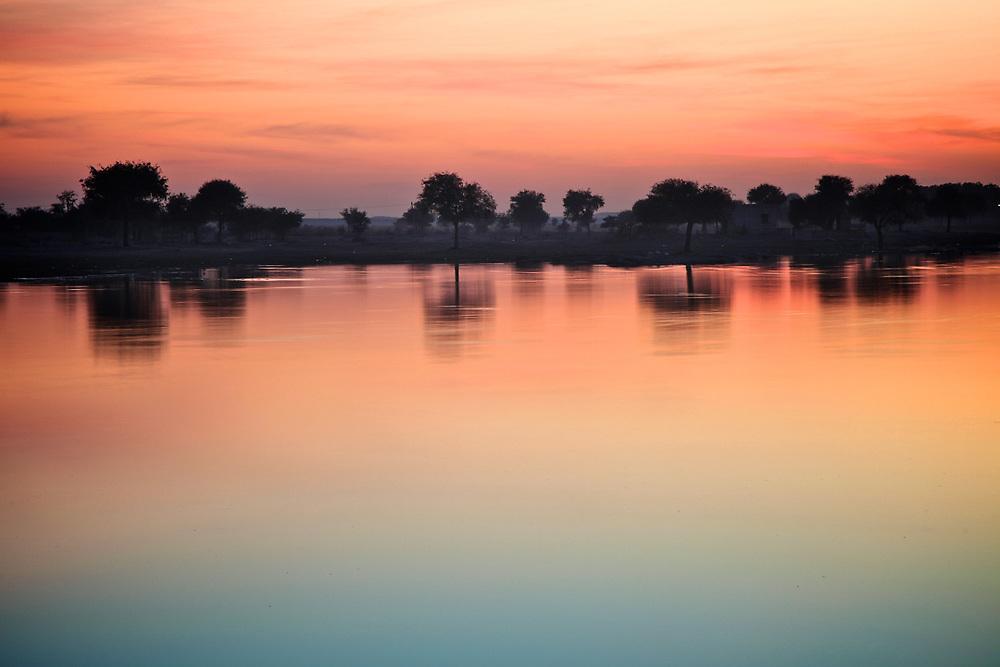 Sunset in Gadisar Lake, Jaisalmer, India. <br /> Photo by Lorenz Berna
