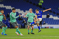 Brighton and Hove Albion midfielder Leandro Trossard (11) shoots at goal from Everton midfielder Tom Davies (26) during the Premier League match between Brighton and Hove Albion and Everton at the American Express Community Stadium, Brighton and Hove, England UK on 12 April 2021.