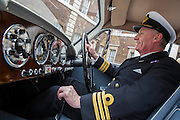 Commander Paul Haines RN tries out the driving position. An Aston Martin DB 2/4, which is understood to have been Ian Fleming's inspiration for James Bond's Aston Martin in the original novel Goldfinger. It was recently discovered and refurbished by owners  John and Daniel Walford.  It is to be auctioned on 12 July at Blenheim Palace  by international auctioneers Coys. The Old Admiralty Building, Whitehall London