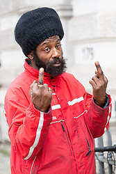 Alleged Grenfell fraudster Alvin Thompson, 50, who claimed to be living in the stairwell of Grenfell Tower, and subsequently received financial and accommodation benefits to the tune of £85,000, makes an obscene gesture as he leaves Westminster Magistrates Court in London. London, January 10 2019.