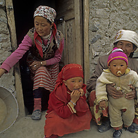The grandmother, mother and children of a nomadic Kyrgiz family relax outside their summer hut in the Pamir Mountains of Xinjiang Province in far western China.