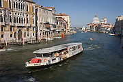 ACTV Vaporetti boat on Venice's Grand Canal seen from Ponte Accademia.