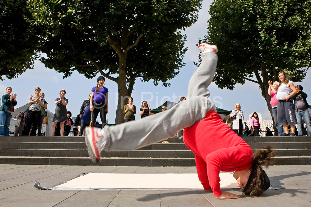 Oxfam launch their Child Birth Mortality 2010 Campaign with a flash mob of break-dancing pregnant women. Around 30 heavily pregnant women arrived on the South Bank for a break dancing event.